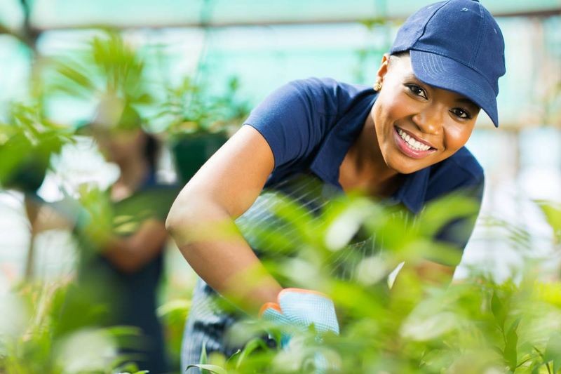 smiling greenhouse worker | jobs in Canada