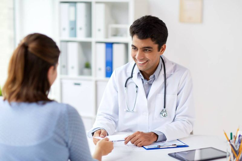 smiling Indian doctor | immigrate to Canada