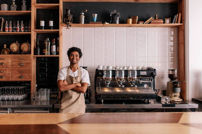 Italian man in his coffee shop small business |  how to apply for a Canadian visa from Italy