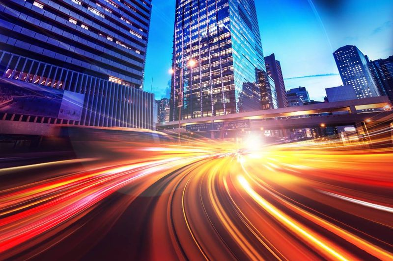 Speeding blurred lights in city  | April Express Entry Draw Roundup 2020 | immigrate to Canada