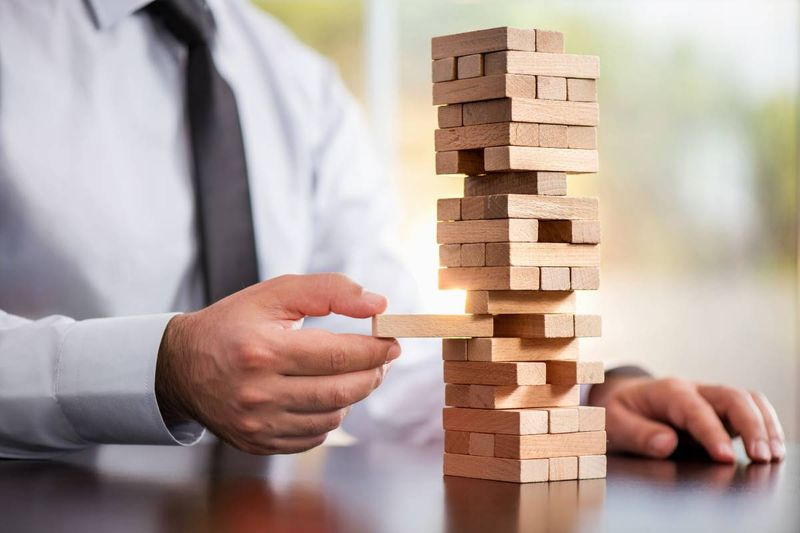 man playing jenga stability concept |  how to apply for a Canadian visa from Chile