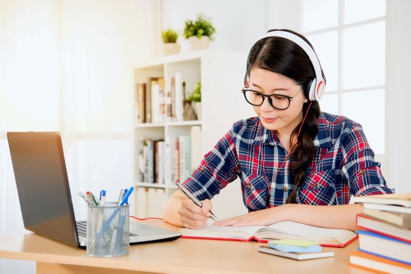 Asian female student studying at desk