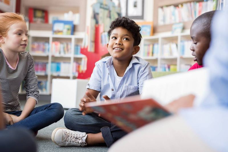 kids sitting in reading circle | study in Canada