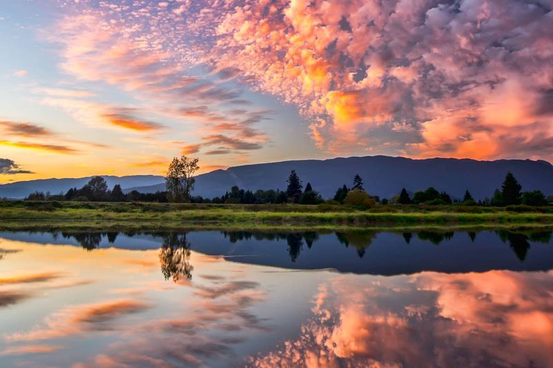 symmetrical photography of clouds covered blue sky pitt meadows british columbia | immigrate to Canada