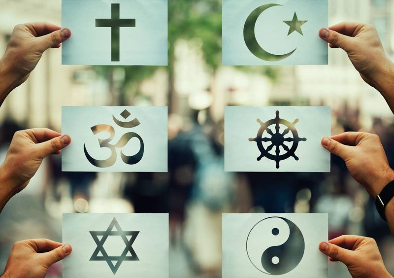 tolerance concept hands holding religious symbols | how to apply for a Canadian visa from Italy