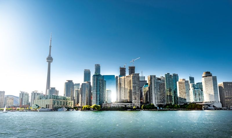 Immigrate to Canada and live in Toronto, Ontario.