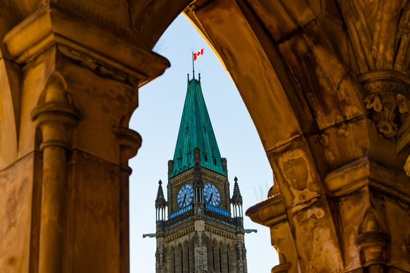 Immigrate to Canada and visit parliament.