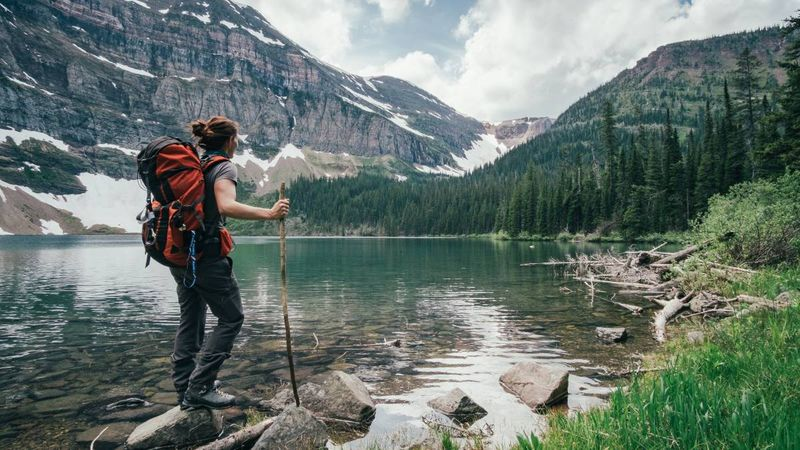 traveller-with-backpack-at-wall-lake-alberta-canada | immigrate to Canada from the UK