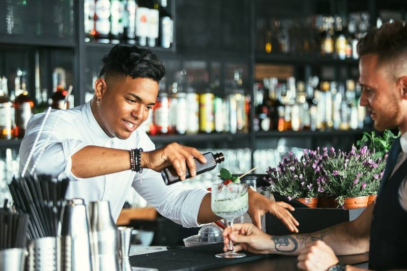 waiter and bartender pouring drink | jobs in Canada