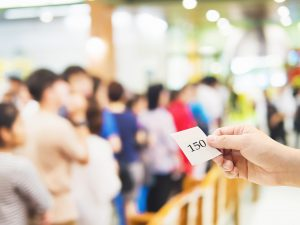 man holding a waiting card number