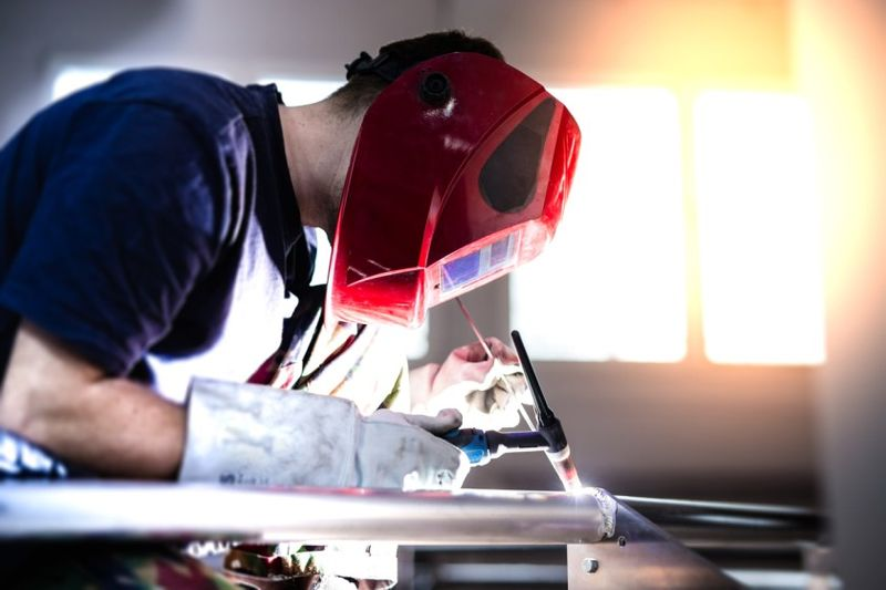young welder at work