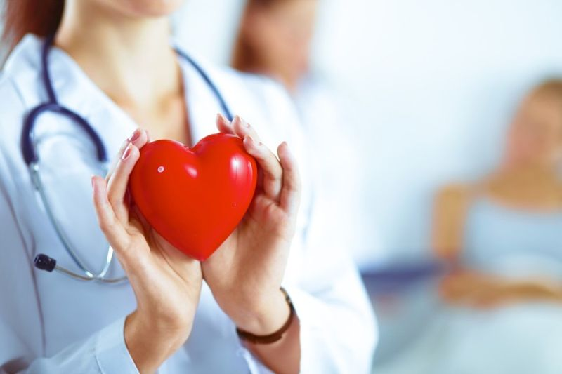 woman holding heart representing health