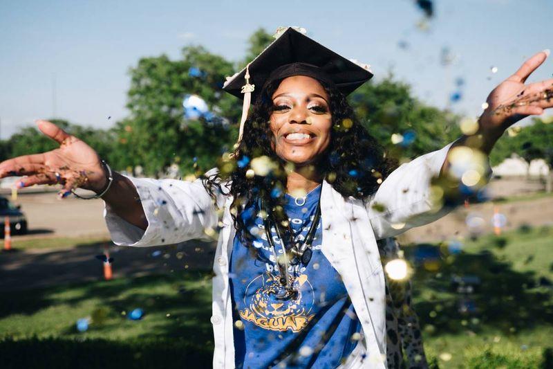 female student graduate throwing confetti in Canada | immigrate to Canada