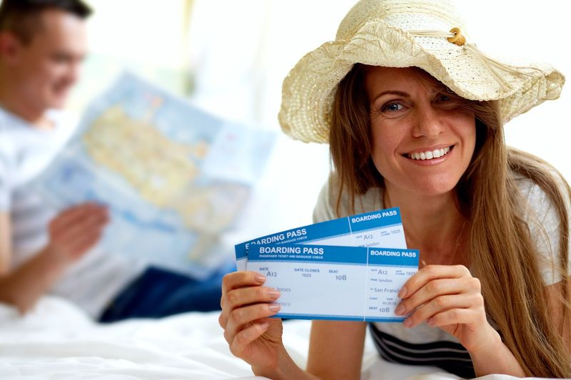Lady holding boarding passes