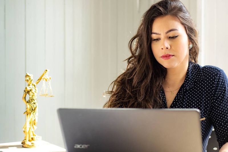 woman applying for graduate program on laptop | immigrate to Canada