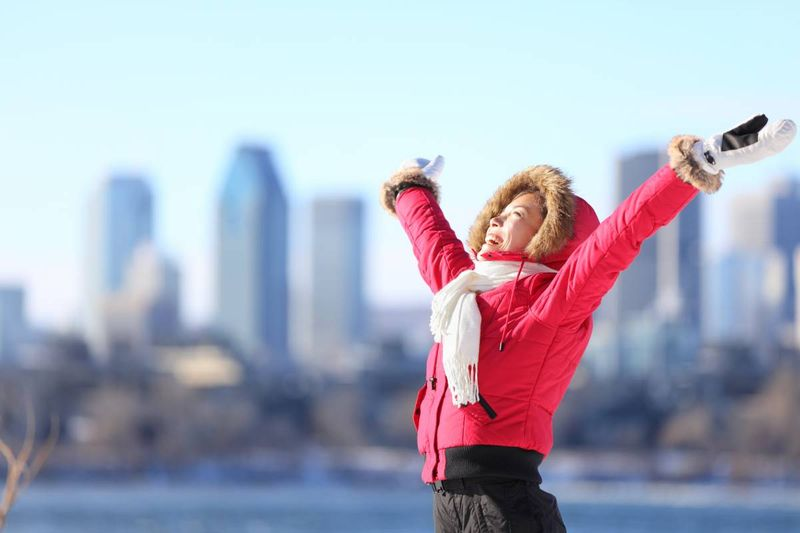 happy woman wearing red jacket after moving to Canada